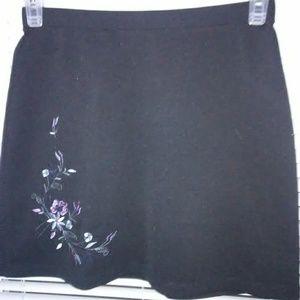 Black short skirt with flower detail on right side